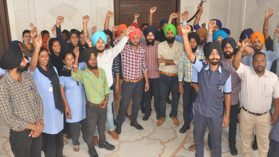 The staff of interpretation centre raising slogans during their protest against the state government outside the Golden Temple in Amritsar on Saturday.