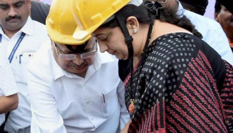 Union minister for textiles and information & broadcasting, Smriti Irani, along with Chhattisgarh CM Raman Singh participates in a cleanliness drive at the 'Swachhta Hi Sewa' campaign, at village Kendri in Raipur.