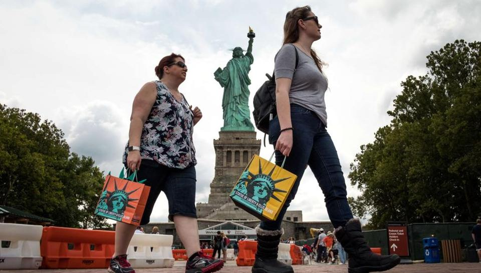 Tourists visiting the Statue of Liberty on Liberty Island in New York City. In 2016, the US witnessed 1.17 million arrivals from India who spent $13.6 billion there.