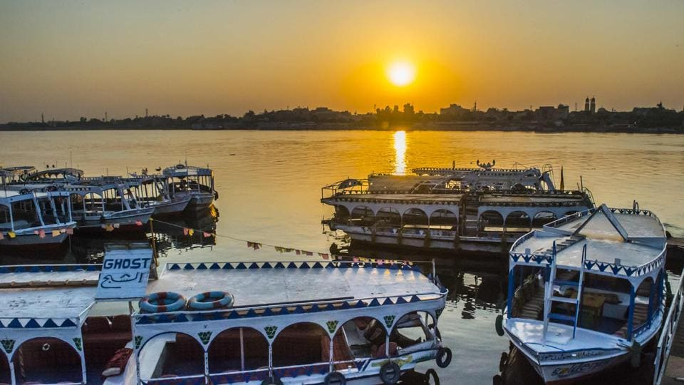 A picture taken on September 10, 2017 shows river boats moored in the Nile at a marina at sunrise in the southern Egyptian city of Luxor. (Khaled Desouki / AFP)