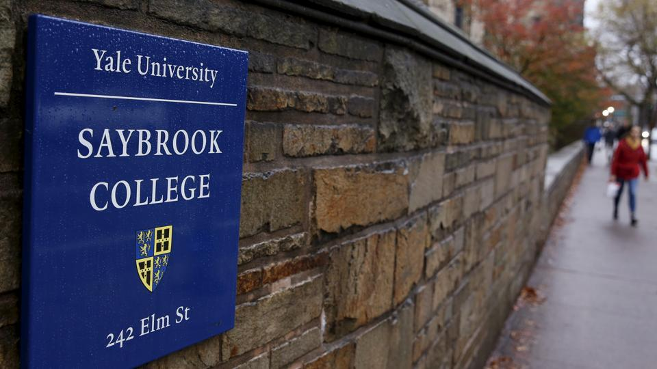 """A sign for the entrance of the Saybrook College is seen on the campus of Yale University in New Haven, Connecticut. Yale University has decided to replace terms such as """"freshman"""" and """"upperclassman"""" with gender-neutral terms."""
