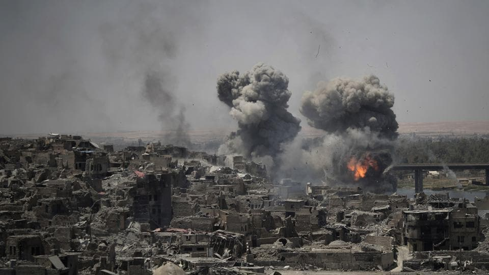 In this July 11, 2017 photo, airstrikes target Islamic State positions on the edge of the Old City a day after Iraq's prime minister declared