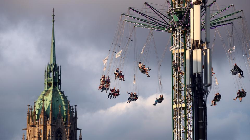 Visitors ride a swing ride during the opening day of the 184th Oktoberfest in Munich, Germany, September 16, 2017. (Michael Dalder / Reuters)