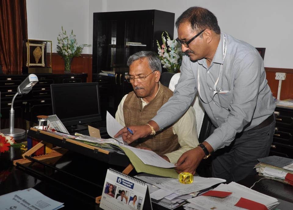 Chief minister TS Rawat goes through reports to be presented before BJP president Amit Shah during his two-day visit to Uttarakhand beginning Tuesday.