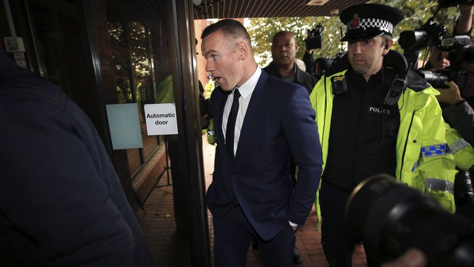 British football player Wayne Rooney arrives at Stockport Magistrates Court on Monday.