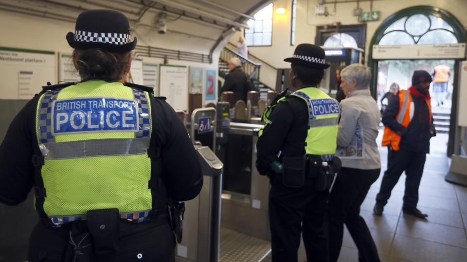 Transport police keep guard at Parsons Green station in London, Monday.