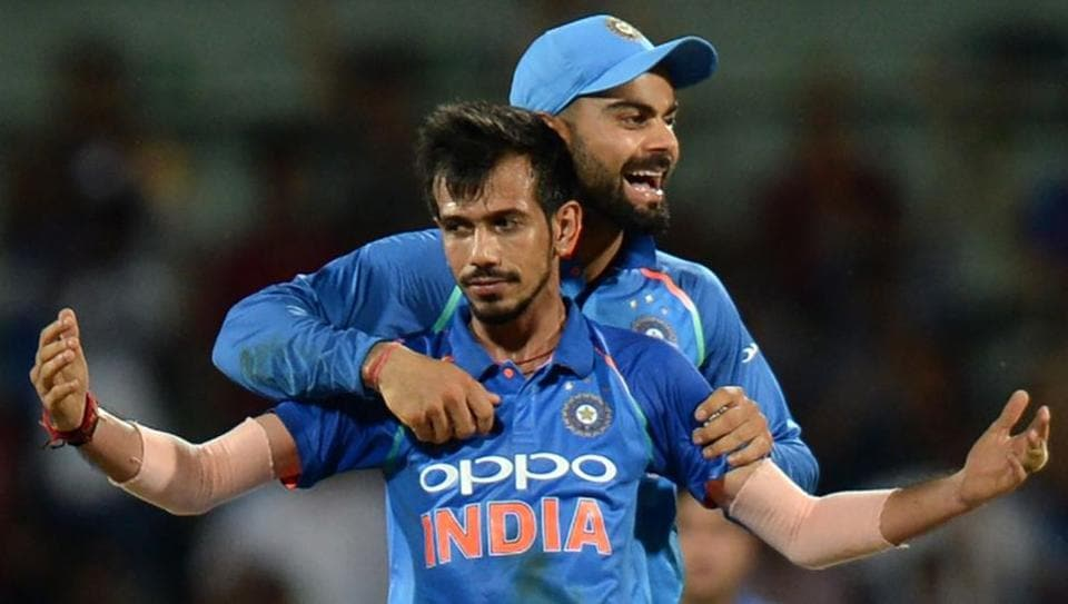 Indian cricketer Yuzvendra Chahal celebrates the wicket of Australian cricketer Glenn Maxwell with captain Virat Kohli during the first One-Day International at the MA Chidhambaram Stadium in Chennai on Sunday.