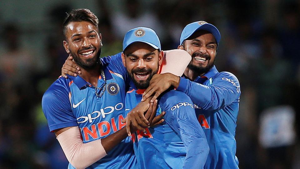 (L to R) Hardik Pandya, Virat Kohli and Kedar Jadhav (L-R) celebrate the dismissal of Steve Smith during the first ODI between India and Australia.