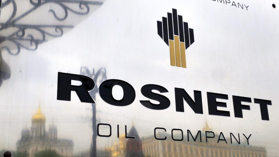 File photo shows the Kremlin being reflected in a plate of the state-controlled Russian oil giant Rosneft at the entrance of the headquarters in Moscow.