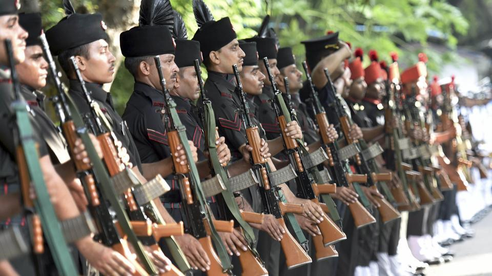 Defence personnel flank the procession for the state funeral of Marshal of the Indian Air Force Arjan Singh in New Delhi on Monday.
