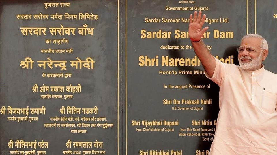 Prime Minister Narendra Modi gestures after inaugurating the Sardar Sarovar Dam