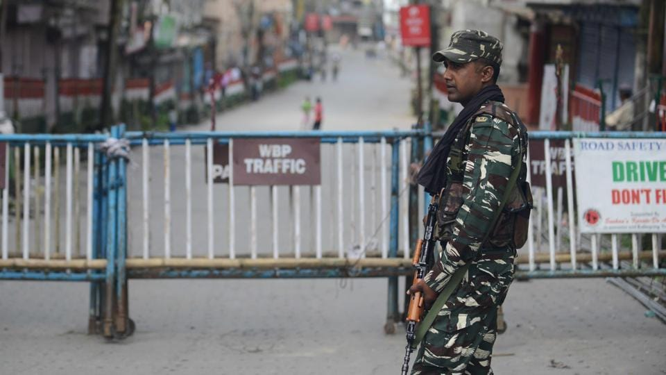 A paramilitary officer stands guard during an indefinite strike called by the Gorkha Janmukti Morcha for separate Gorkhaland in Kalimpong earlier this month.