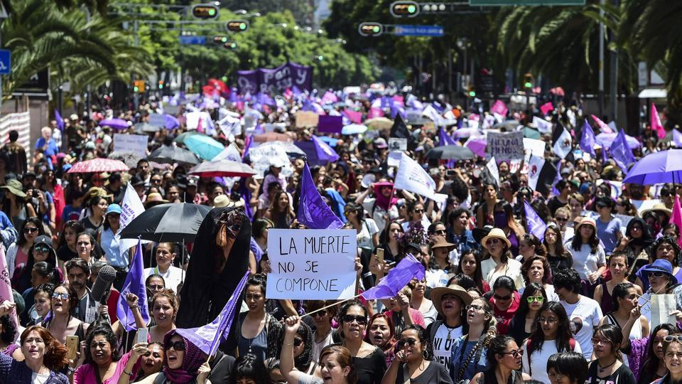 Mexicans protest against murders and other violence against women in Mexico City on Sunday.