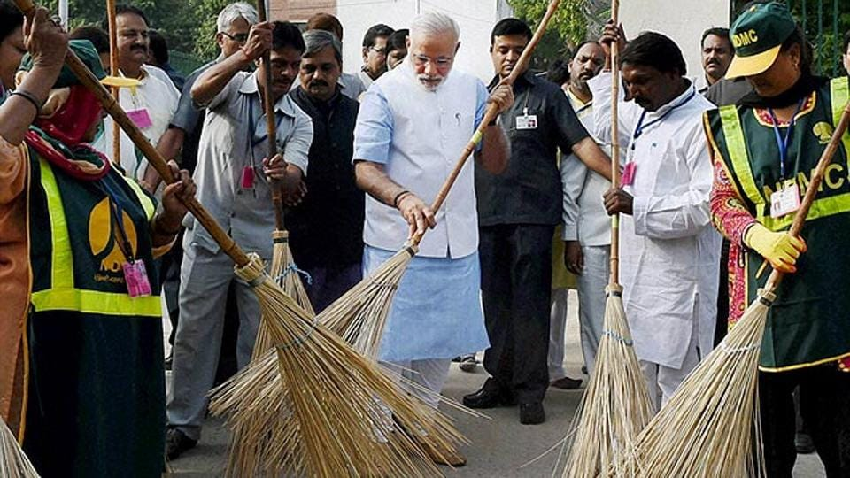 Prime Minister Narendra Modi wields a broom with NDMC workers to launch the Swachh Bharat Abhiyan in New Delhi in 2015.