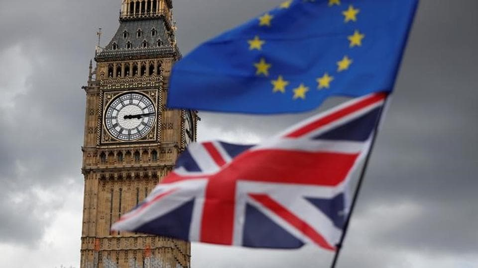 The Union Flag and a European Union flag fly near the Elizabeth Tower, housing the Big Ben bell, during the anti-Brexit 'People's March for Europe', in Parliament Square in central London, Britain September 9, 2017.