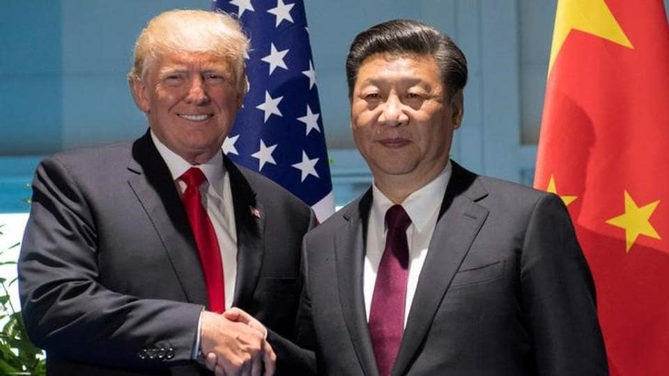 US President Donald Trump and Chinese President Xi Jinping (R) shake hands prior to a meeting on the sidelines of the G20 Summit in Hamburg, Germany, July 8, 2017.