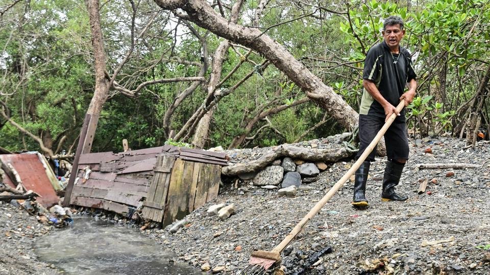 Rehan Merchant clears Bandra mangroves of muck in Mumbai on Saturday.