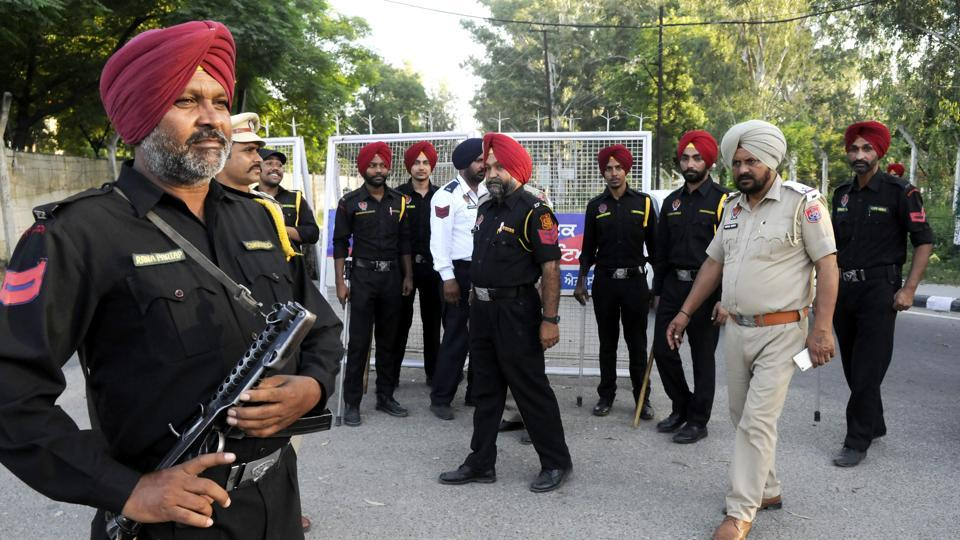 Punjab police personnel stand guard on the road leading to chief minister Amarinder Singh's residence in Patiala on Monday.