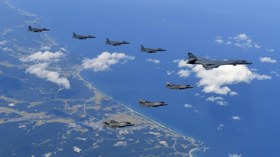 A photo provided by South Korea's defence ministry shows US Air Force B-1B bomber, F-35B stealth fighter jets and South Korean F-15K fighter jets flying over the Korean Peninsula during joint drills on Monday.