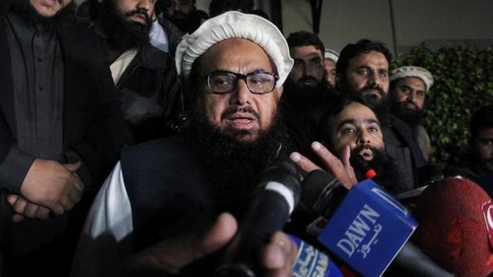 Hafiz Muhammad Saeed speaks with media as he is escorted to his home in Lahore, Pakistan January 30, 2017.