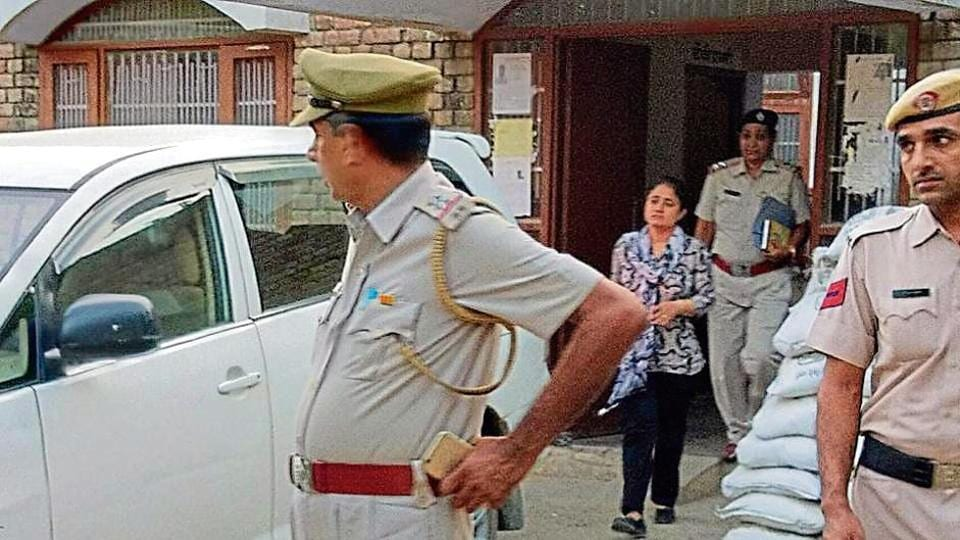 Dera Sacha Sauda chairperson Vipassana coming out of the HUDA police post inSirsa after joining police investigation.