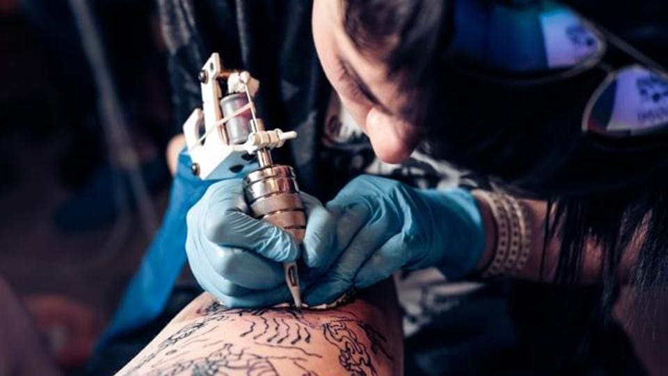 Researchers say the tattoo salon should provide clients with information on how to care for the area that has been tattooed or pierced afterward.