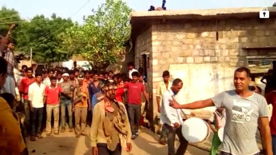 Vikram Adiwasi, Kotu Adiwasi and Satish Adiwasi are paraded through Khareh village in Madhya Pradesh's Shivpuri district.