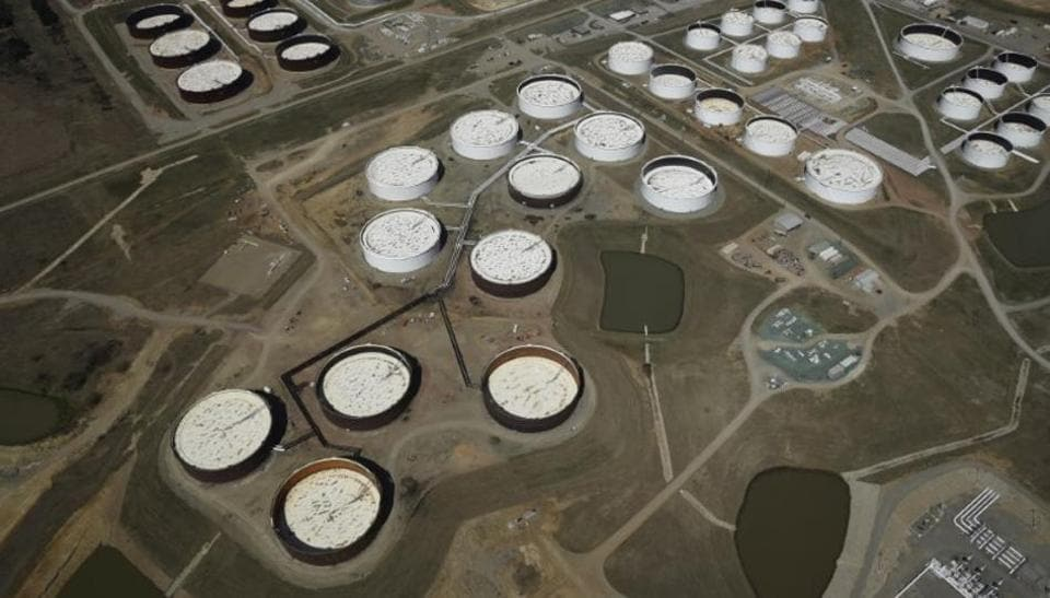 Crude oil storage tanks are seen from above at the Cushing oil hub, in Cushing, Oklahoma, US.