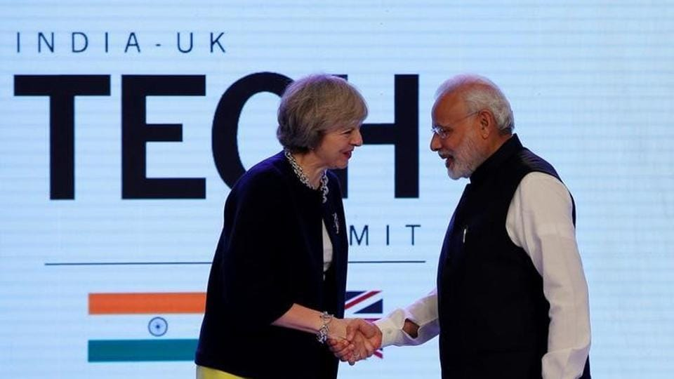 Britain's Prime Minister Theresa May shakes hands with Prime Minister Narendra Modi during the India-UK Tech Summit in New Delhi, November 7, 2016