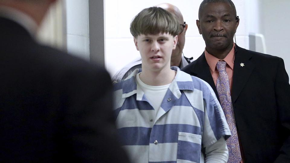 In this Monday, April 10, 2017, file photo, Dylann Roof enters the court room at the Charleston County Judicial Center to enter his guilty plea on murder charges in Charleston, SC Roof.