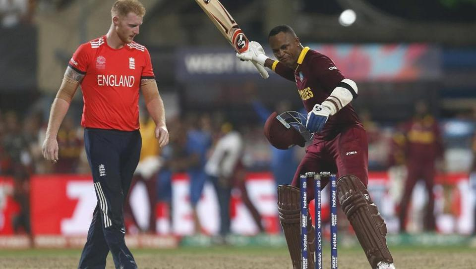 West Indies Marlon Samuels (R) celebrates past England's Ben Stokes after winning the World T20 cricket final in Kolkata on April 4, 2016. The two will face off in the first England vs West Indies ODI in Manchester on Tuesday.