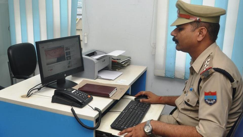 An official at work at the cyber crime police station in Dehradun.