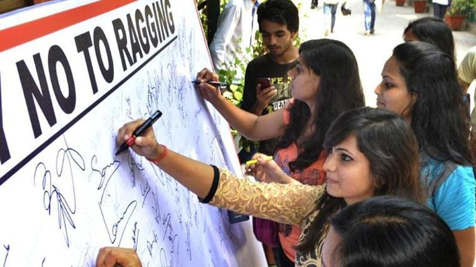 Students sign a pledge against ragging at the Hansraj College in New Delhi.