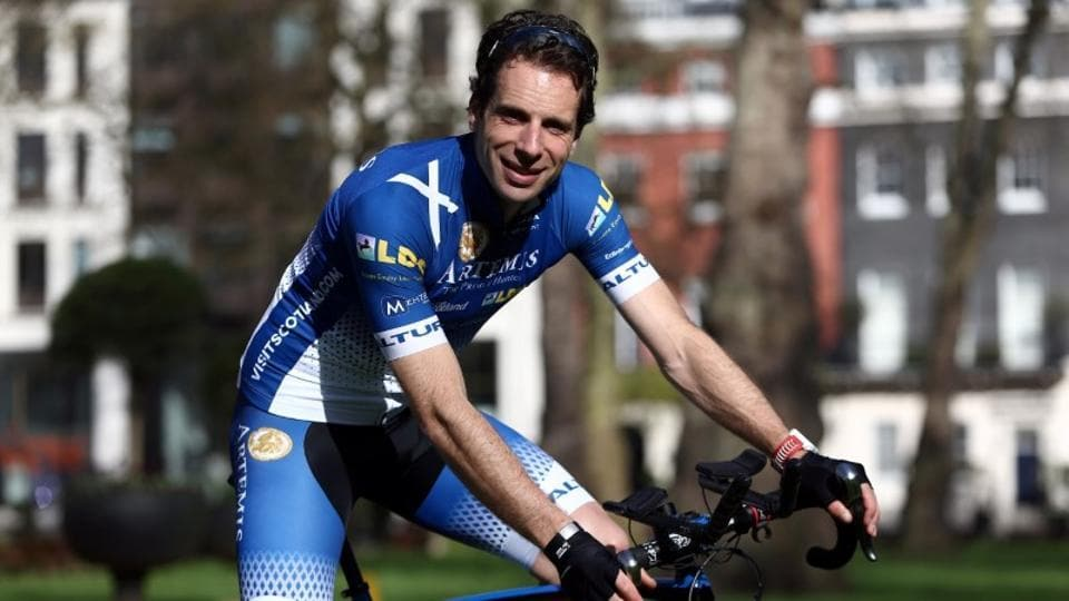 Endurance cyclist Mark Beaumont, who is aiming for a record-breaking circumnavigation of the globe in 80 days in July, poses during a photocall in central London, Britain April 2, 2017.