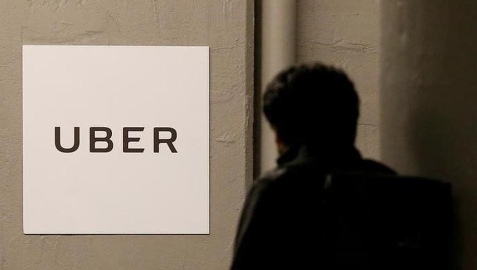 A man arrives at the Uber offices in US.