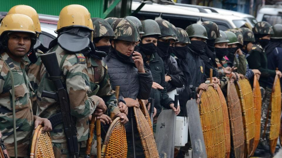 Security personnel stand guard amid an indefinite strike called by the Gorkha Janmukti Morcha in Darjeeling on July 5, 2017. Darjeeling has been rattled at the height of tourist season after violent clashes broke out between police and hundreds of protesters who want a separate state for Gorkhas in West Bengal.