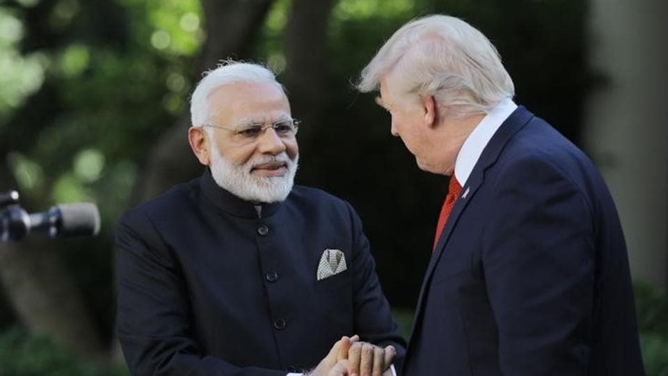 US President Donald Trump (R) greets Indian Prime Minister Narendra Modi during their joint news conference in the Rose Garden of the White House in Washington, US, June 26, 2017.