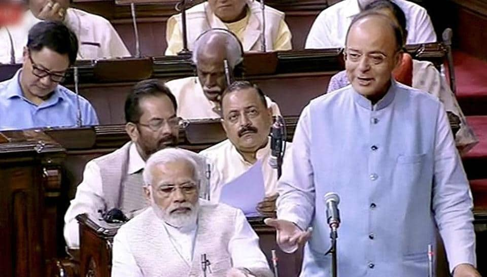 Finance minister Arun Jaitley speaks in the Rajya Sabha in New Delhi. Prime Minister Narendra Modi is also seen.