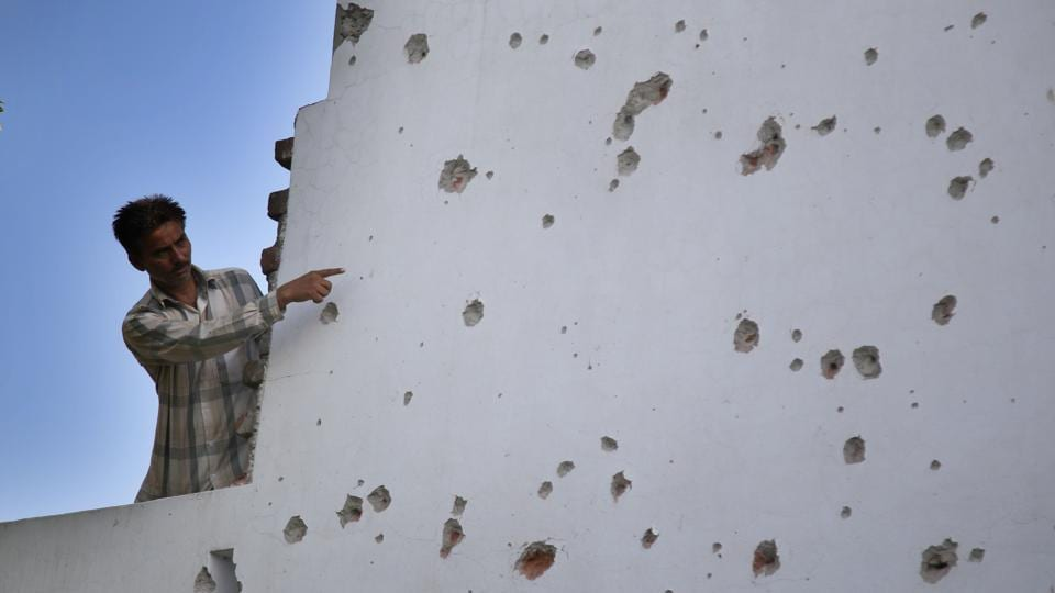 A Villager shows the damaged wall of his house after a heavy mortar shelling by Pakistani rangers on Saturday night, at Arnia village, Jammu, on September 17.