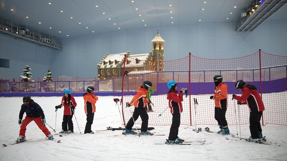 People ski at the Wanda Harbin Ice and Snow Park in Harbin.