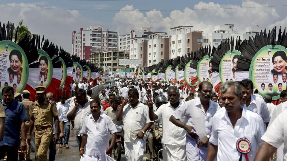AIADMK workers head towards the party's general council and executive committee meeting in Chennai on Tuesday.