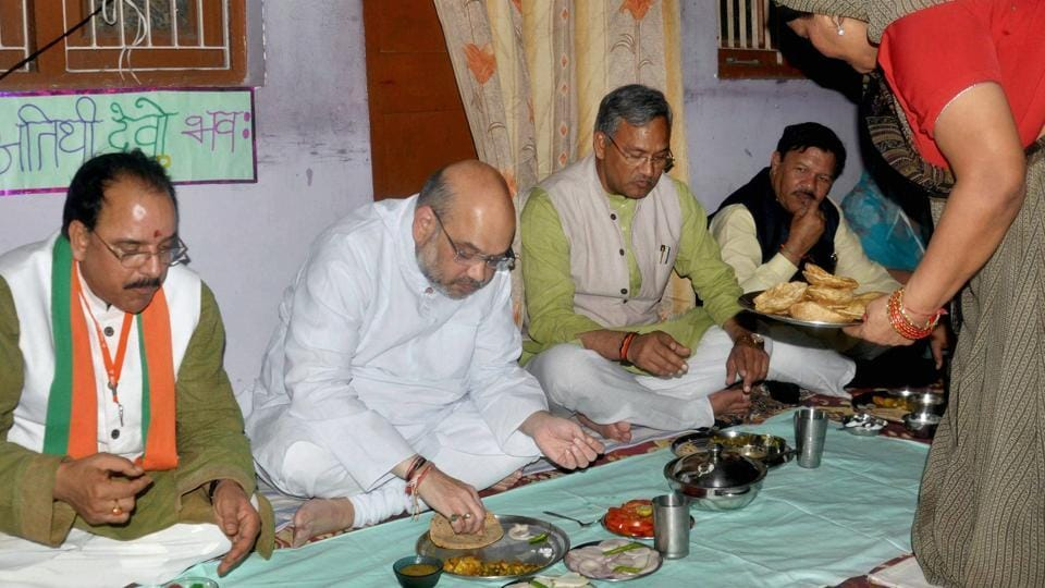 Bharatiya Janata Party national president Amit Shah along with Uttarakhand chief minister Trivendra Singh Rawat and state BJP president Ajay Bhatt have lunch at Dalit's house, in Dehradun on Wednesday.