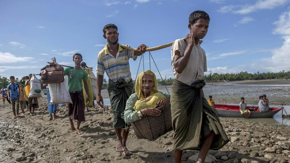 Rohingya Muslim refugees carry an elderly woman in a basket and walk towards a camp in Shah Porir Dwip, Bangladesh, September 14. Nearly three weeks into a mass exodus of Rohingya fleeing violence in Myanmar, thousands were still flooding across the border in search of help and safety in refugee settlements in Bangladesh.