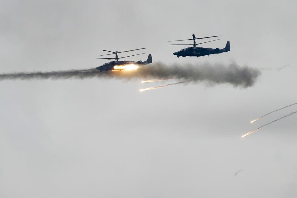 Military helicopters fire during the Zapad 2017 Russia-Belarus military exercises at the Borisovsky range in Borisov, Belarus on September 20, 2017.