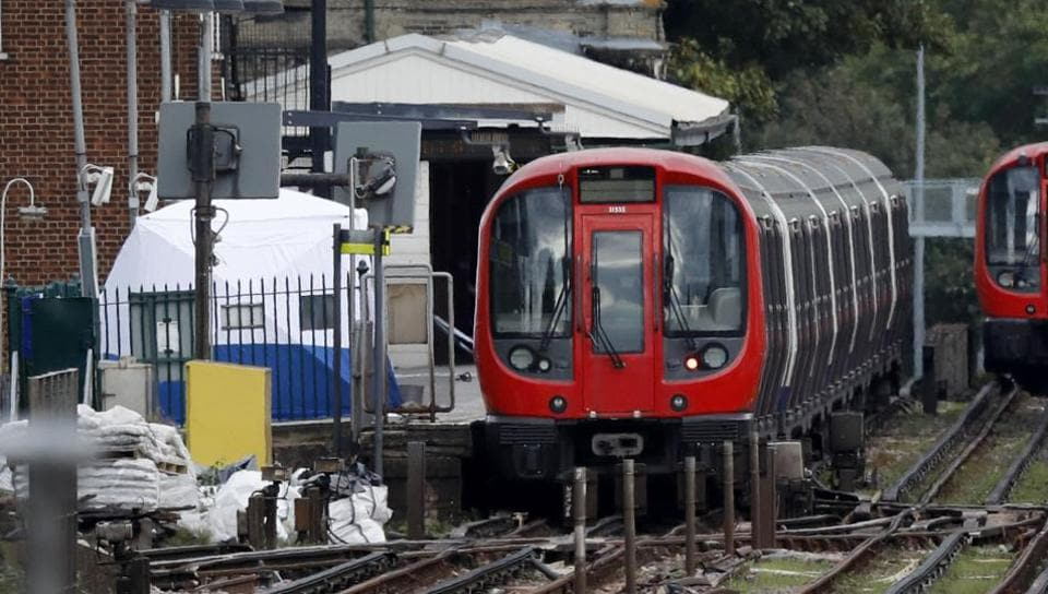 A police forensic tent stands setup on the platform next to the train on which a homemade bomb exploded at Parsons Green subway station in London on September 15, 2017.