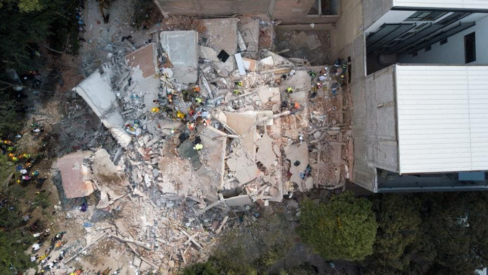 Emergency personnel in Mexico City, a metropolitan region of about 20 million people, searched frantically with picks and shovels for survivors beneath the rubble of what the sprawling city's mayor calculated to be as many as 44 collapsed buildings, including at least one primary school. The media in Mexico reported that families were getting WhatsApp messages pleading for help from desperate relatives trapped under the debris. (Rafael Arias / Social Media / via REUTERS )