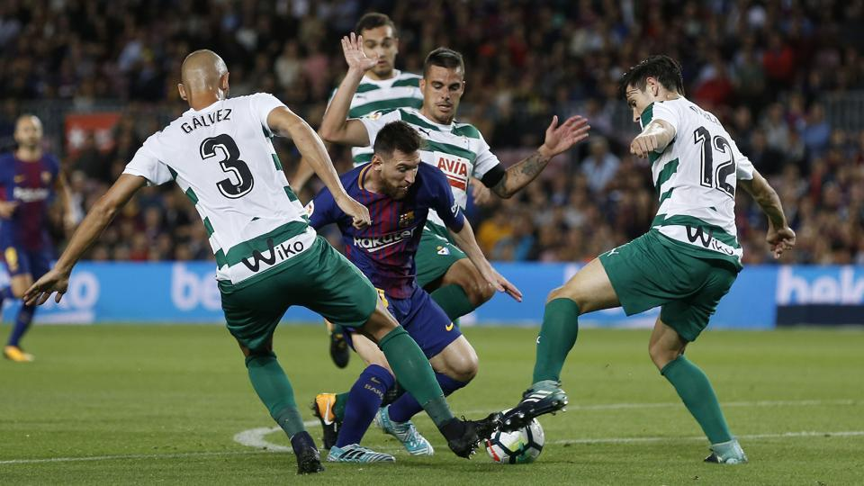 Lionel Messi (C) vies with Eibar players during the Spanish league football match between FC Barcelona and SD Eibar at the Camp Nou stadium in Barcelona on September 19, 2017.