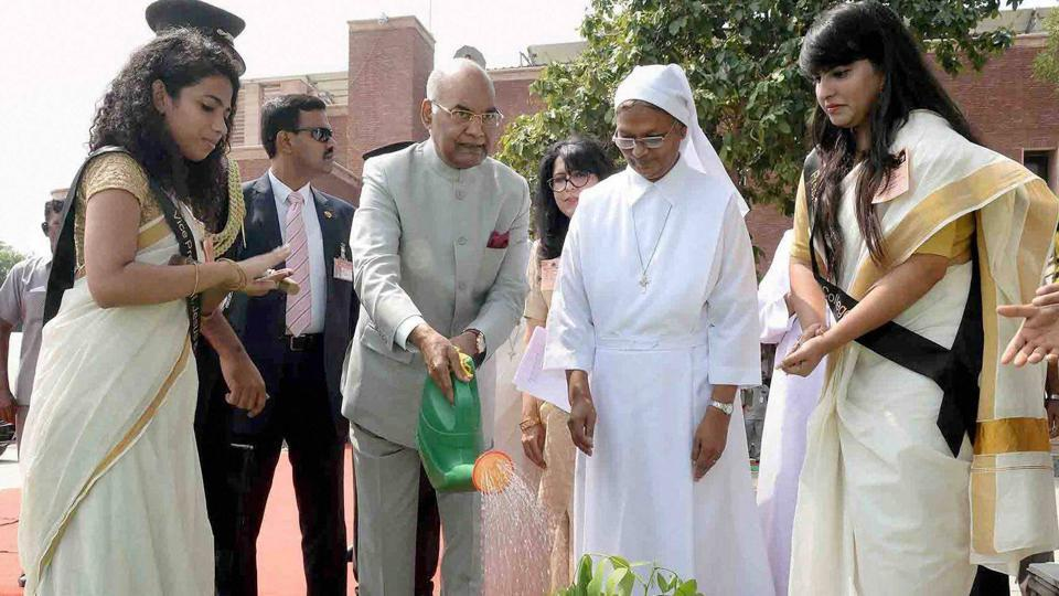 President Ram Nath Kovind watering a plant during the inaugural function of golden jubilee celebrations of Jesus & Mary College at Chanakyapuri, in New Delhi on Wednesday.