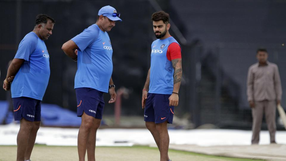 Virat Kohli and Ravi Shastri inspect the pitch for the second ODI in Kolkata. (AP)