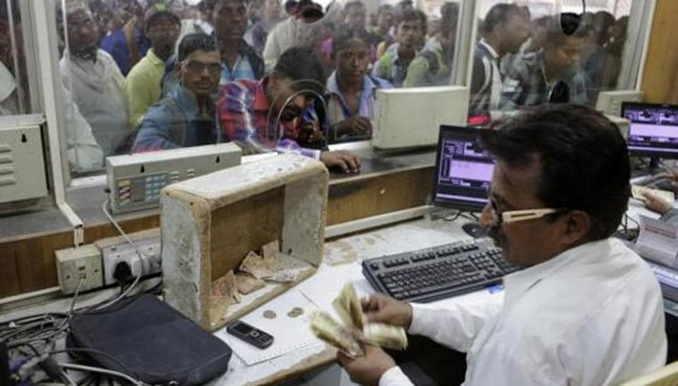 A Railways staff counts currency notes at a ticket counter in Allahabad, India.